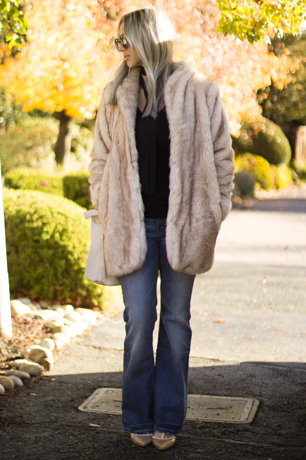 faux fur coat with flare jeans