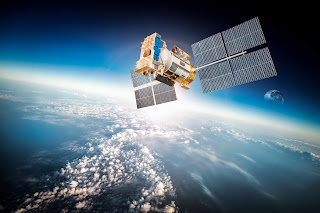 communications satellite orbiting the earth