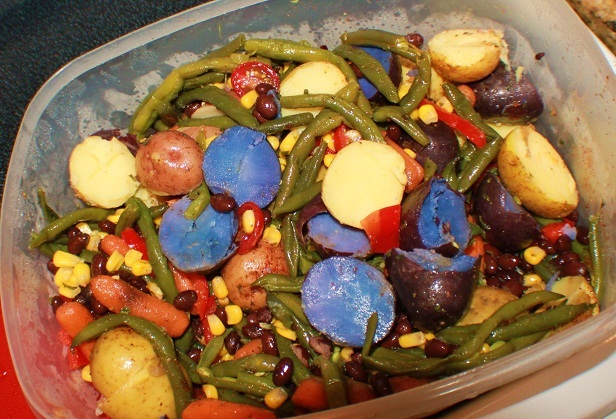 Red white and blue side dish or appetizer this is a festive 4 th of july colors of blue potatoes, red potatoes and white in a bean salad southwestern style  for the 4th of July or Memorial Day Parties
