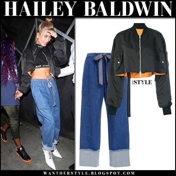 Hailey Baldwin in black cropped bomber jacket unravel and blue denim pants august 23 2017