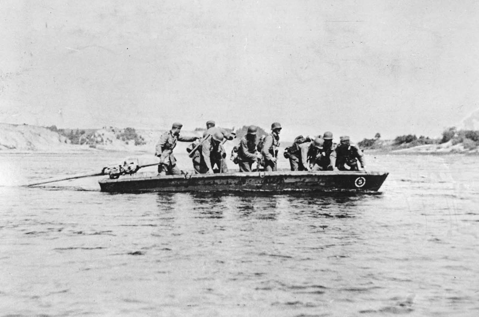 German soldiers cross a river, identified as the Don river, in a stormboat, sometime in 1941, during the German invasion of the Caucasus region in the Soviet Union.