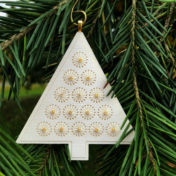 cream colored paper tree ornament with gold stitched design with gold seed beads