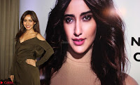 Neha Sharma Pos At Mobile App Launch 1.jpg