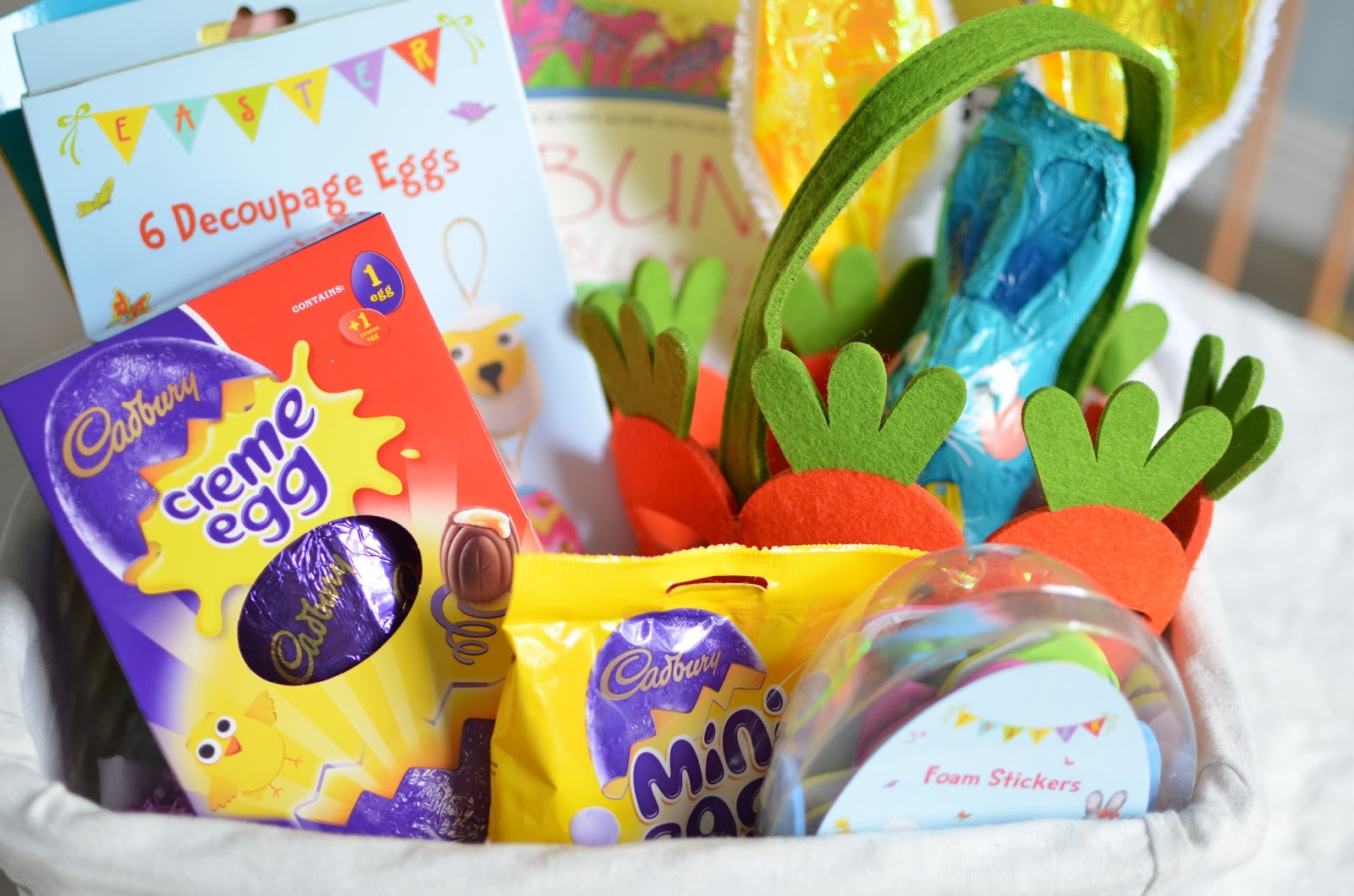 Whats in my toddlers easter basket oh little one sweet i love the felt carrot easter egg hunt basket which i got for about 150 at asda negle Image collections