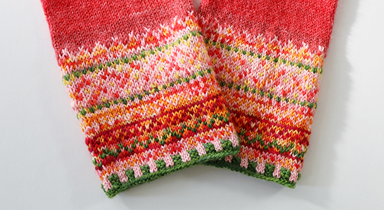 The Cuffs of a Pair of Meida's Mittens Knit with Bright Nontraditional Colors