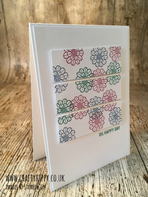 White greetings card with three horizontal panels with Sweet Sugarplum, Emerald Envy and Dapper Denim flowers stamped using the Touches of Texture stamp set by Stampin' Up!