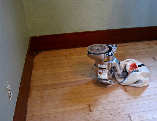 Edger Sanding Hardwood Floor Edging Along Wall
