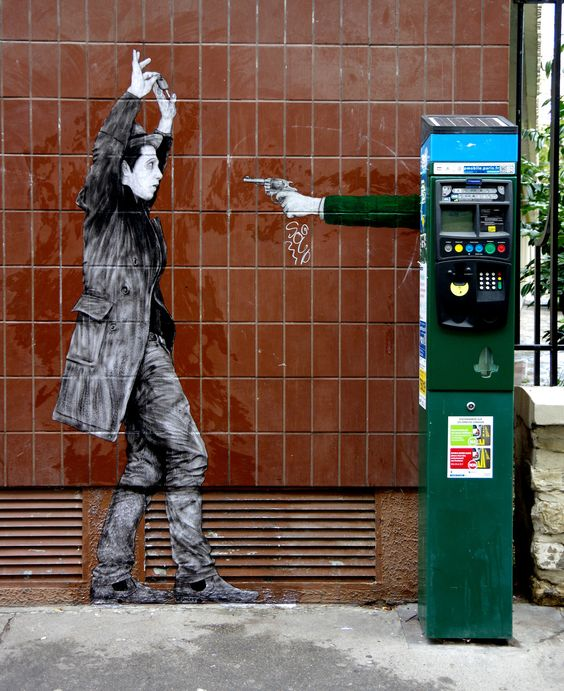 """STREET ART: """"Hold Up"""" by Levalet in Paris"""