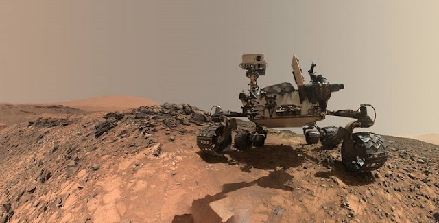 "This low-angle self-portrait of NASA's Curiosity Mars rover shows the vehicle at the site from which it reached down to drill into a rock target called ""Buckskin"" on lower Mount Sharp. Credits: NASA/JPL-Caltech/MSSS"