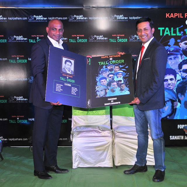2.Sanath Jayasuriya unveiling the book along with  Kapil Pathare