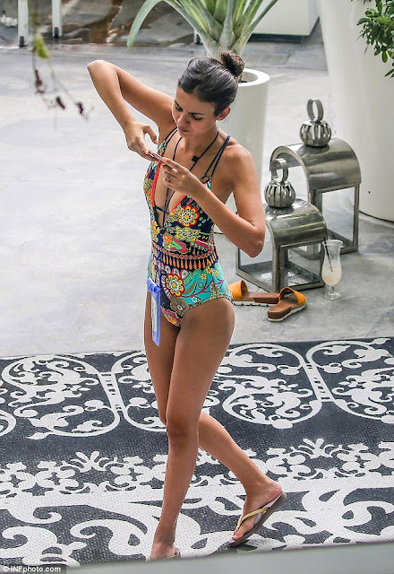 Victoria Justice in plunging bohemian print bathing suit in Miami