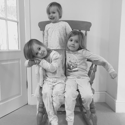 My girls now 6, almost 4 and 2 all sitting in the rocking chair