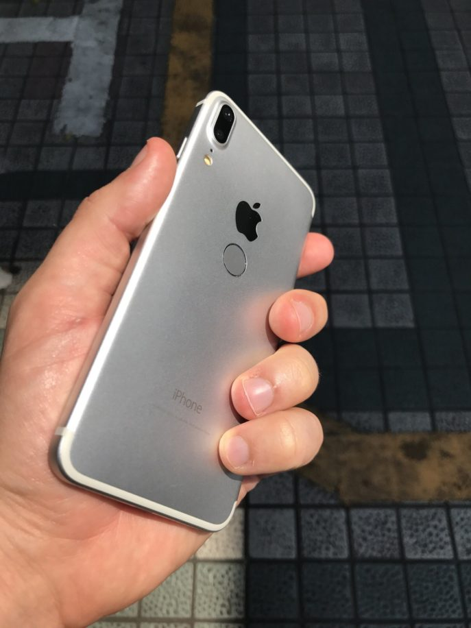 A picture of iPhone 8 dummy has been shared on Twitter by Benjamin Geskin which shows Apples upcoming iPhone 8 with larger display, small bezel, vertical dual camera system and rear Touch ID.