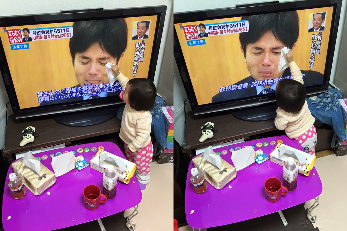 This precious little girl tries to wipe away the tears of the man she sees weeping on the television screen.