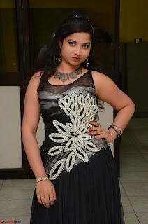 Shrisha Dasari in Sleeveless Short Black Dress At Follow Follow U Audio Launch 032.JPG