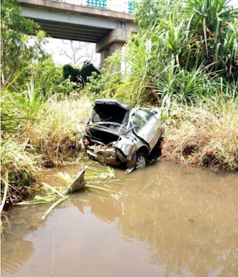 Lady Survives Ghastly Accident As Vehicle Falls Off A Bridge (Photos)