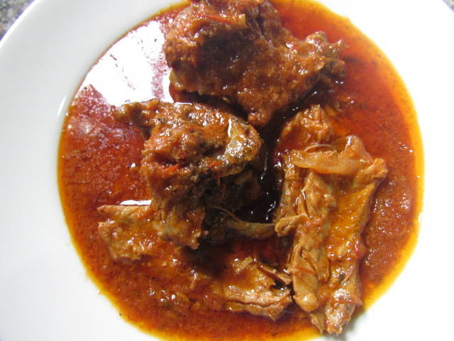 Tomatoes stew with fish and meat
