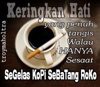 Segelas kopi sebatang roko