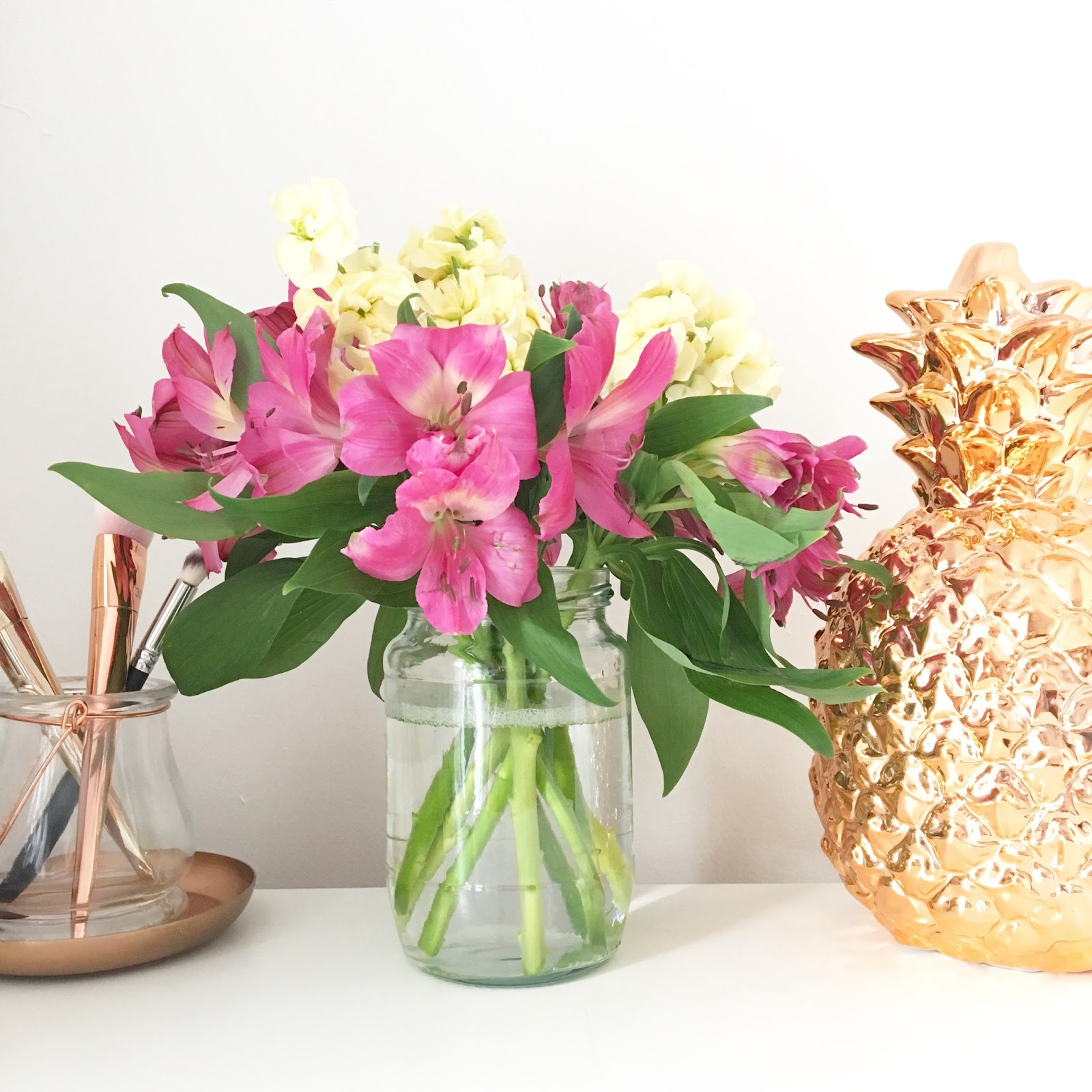 Copper pineapples and pretty pink flowers