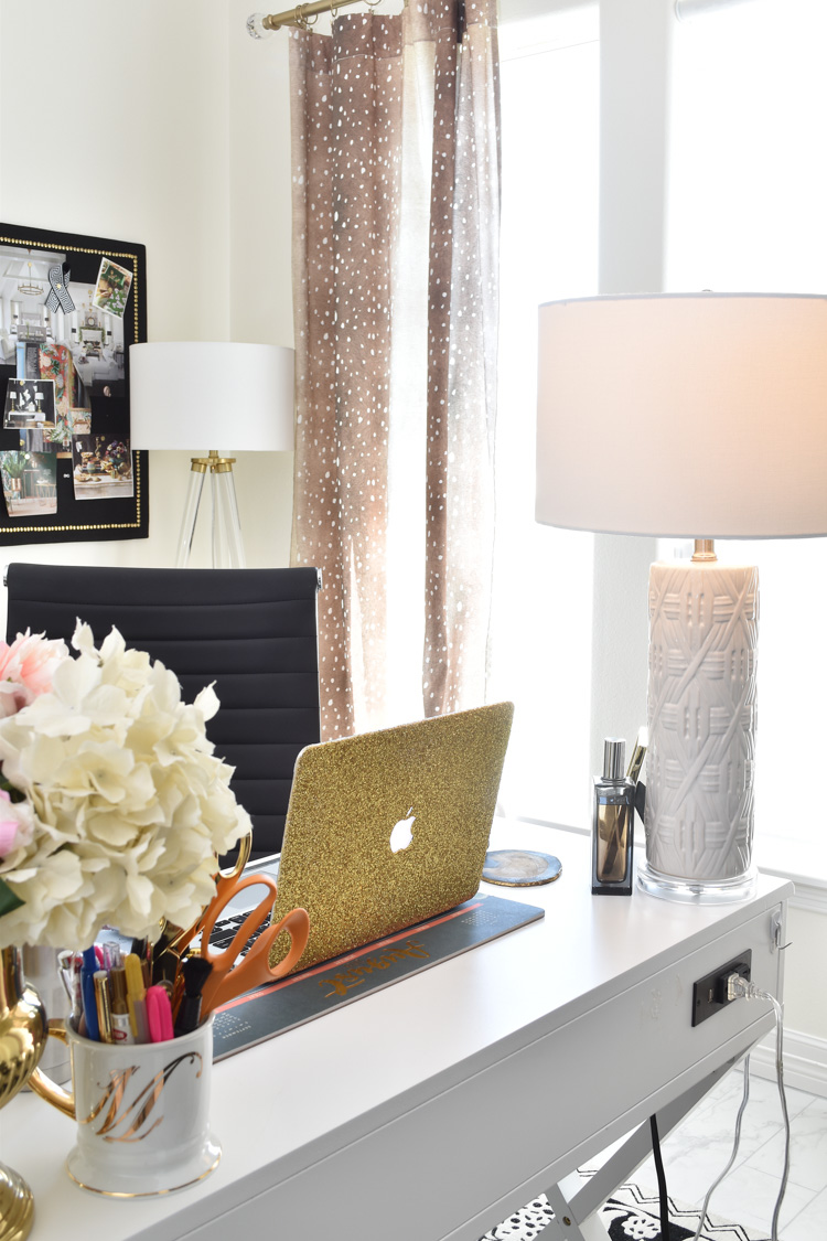 A STUNNING home office with perfect lighting and black, white and gold decor and accents. Love the antelope curtains and alabaster white walls.