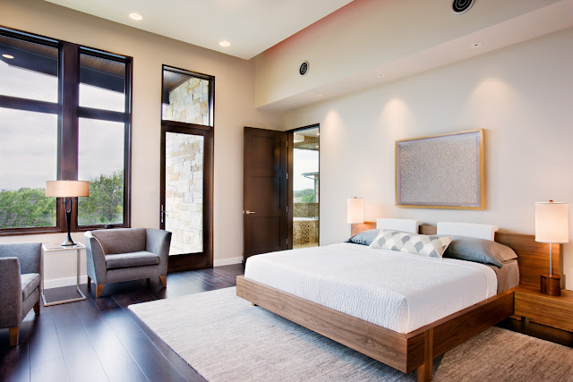 Photo of modern bedroom interiors with large bed and large windows