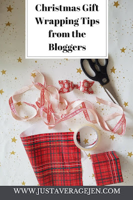 Picture of wrapping items eg sellotape on a background of white with gold stars with the words Christmas Wrapping Tips from the bloggers