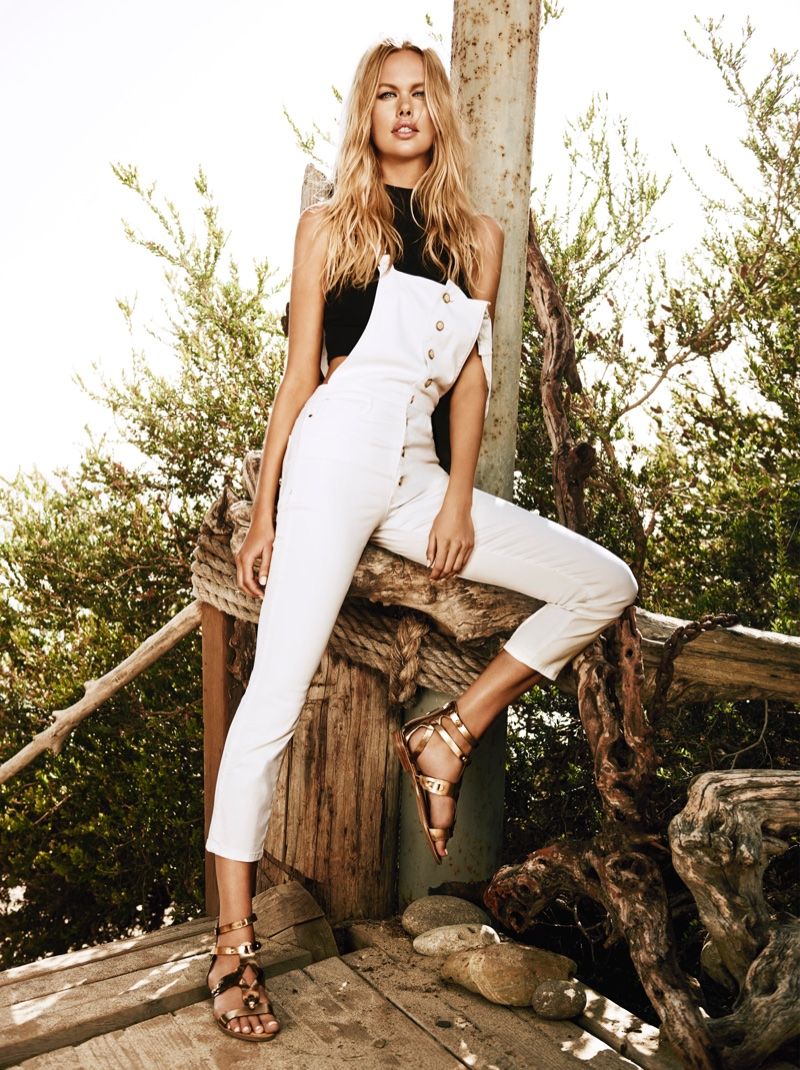 Emma Stern poses in Guess Shayne ever white button-down overalls