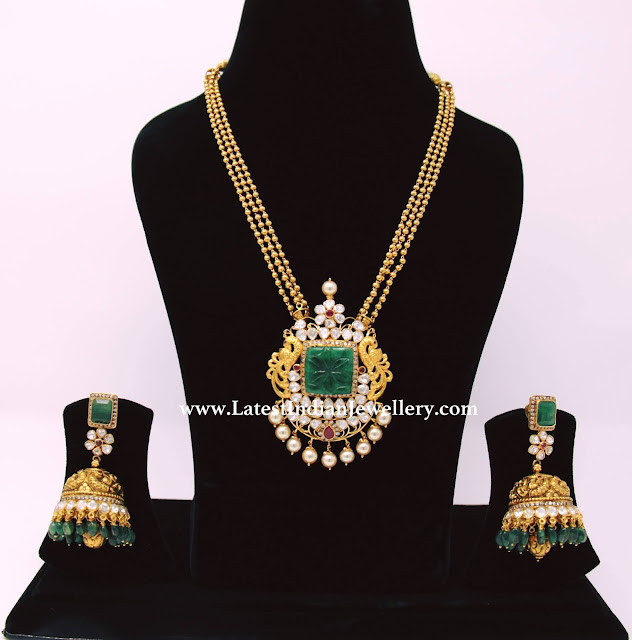 Emerald Highlighted Polki Pendant Jhumkas