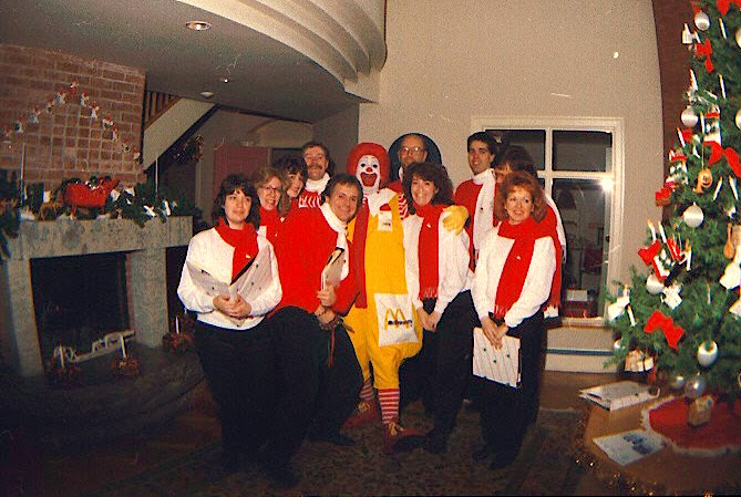 The Stairwell Carollers pose with Ronald at Ronald McDonald House 1986