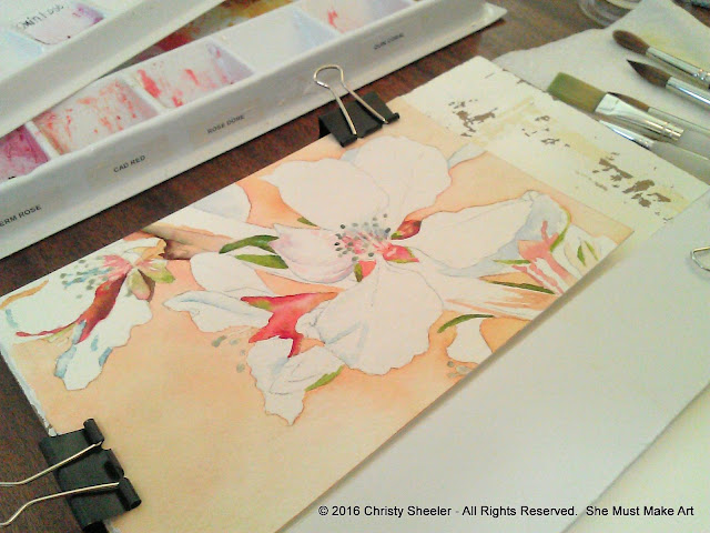 First layers of watercolor paint laid in for the main subject, cherry blossoms.