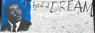 Banner with painting of Dr. Martin Luther King, Jr and student notes