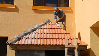 Sally, with sleeves rolled up, fits the ridge tiles