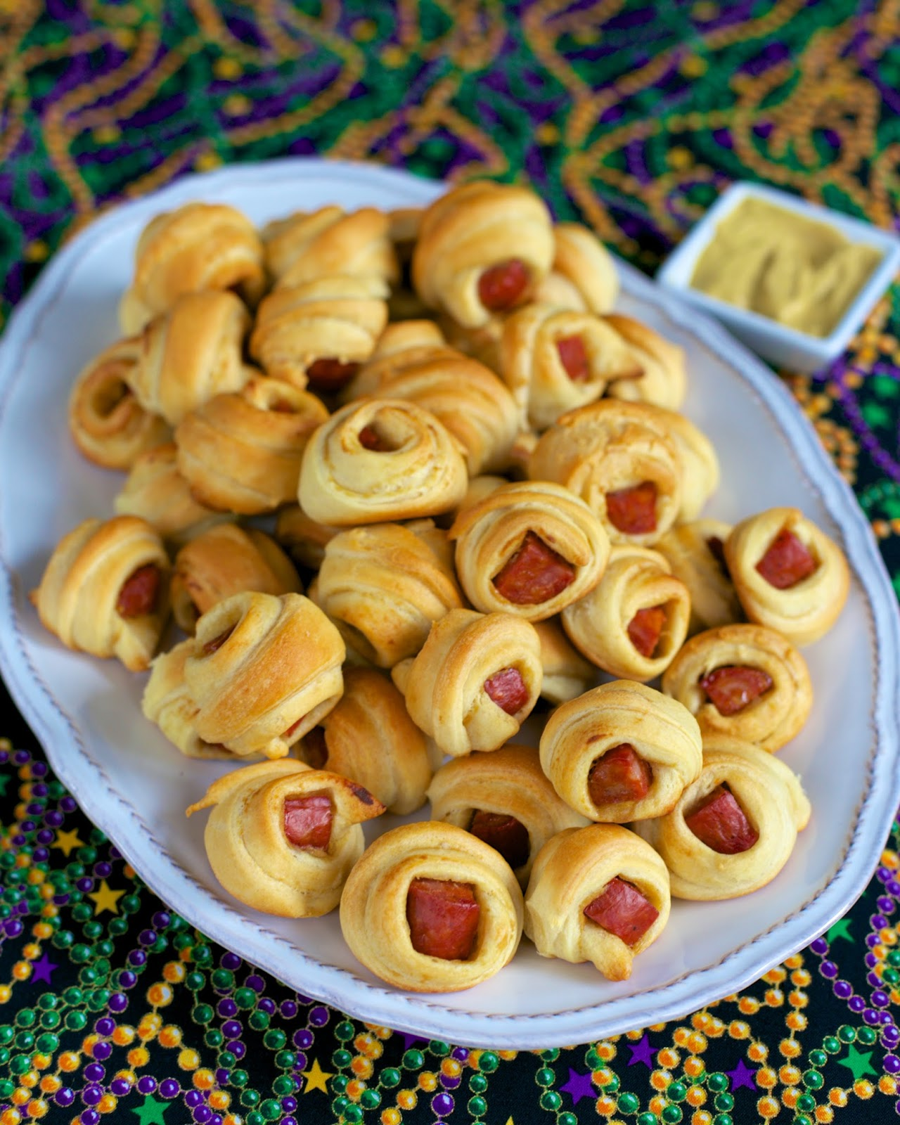 Andouille Pig in a Blanket - kick up ordinary pigs in a blanket with andouille sausage. Only 3 ingredients - andouille, mustard and crescent rolls.