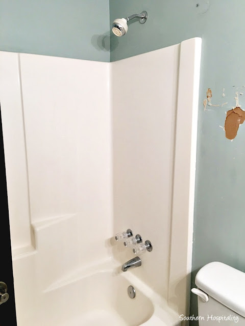 Tearing out bathtub with surround
