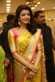 Actress Kajal Agarwal Stills in Golden Silk Saree at Trisha Sesigner Store Launch  0084.jpg
