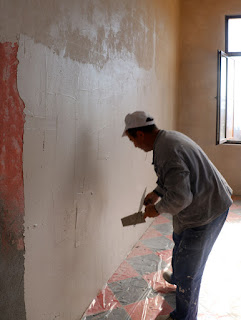The final wall is being plastered
