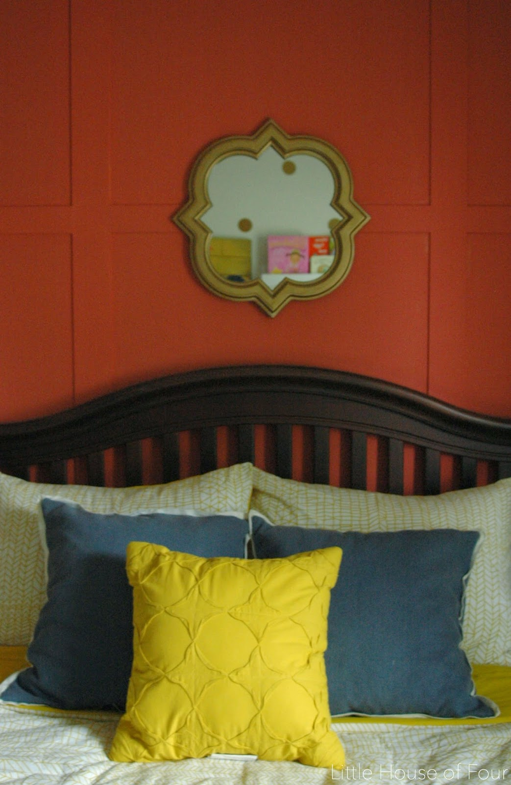 Blue and yellow pillows on bed