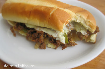 Philly Cheesesteak Sandwiches are filled with seasoned sirloin steak, bell peppers, onions and lots of gooey cheese. Life-in-the-Lofthouse.com