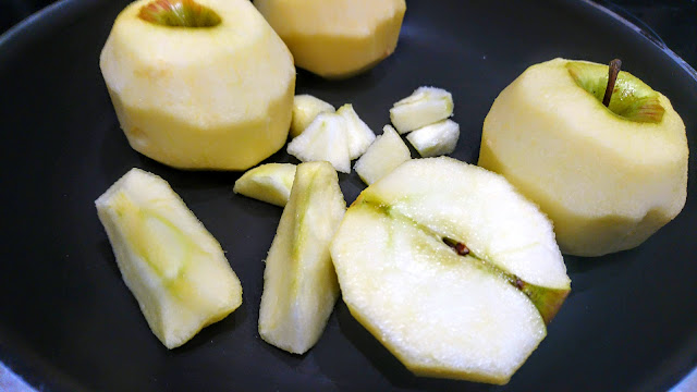 peeled apples in a pan
