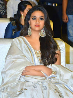 Keerthy Suresh in White Dress with Cute Smile at Pandem Kodi 2 Pre Release Event in Hyderabad 2