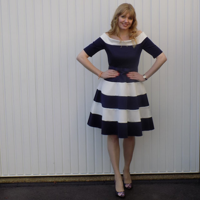 Navy and white prom dress with floral Ted Baker shoes