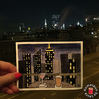 watercolor painting of NYC skyline and cocktails