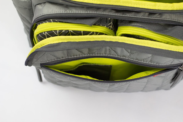 A close up view of the smaller compartment and front pocket