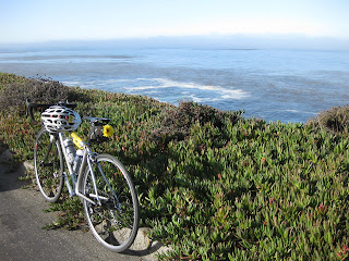 Bicycle next to ice plant on a Pacific coast cliff at Granite Canyon