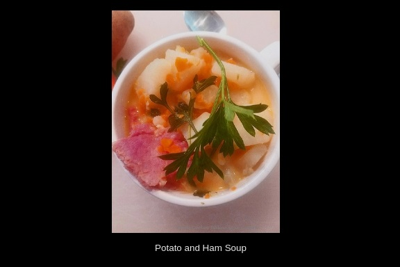 This is the easiest way to make potato soup. This soup is a potato soup with ham, it's a no fuss soup with vegetables ham and very low in calories. This potato soup has carrots, celery, ham all in a rich creamy broth made all in one pan. This is in a soup cup with vegetable design on it.