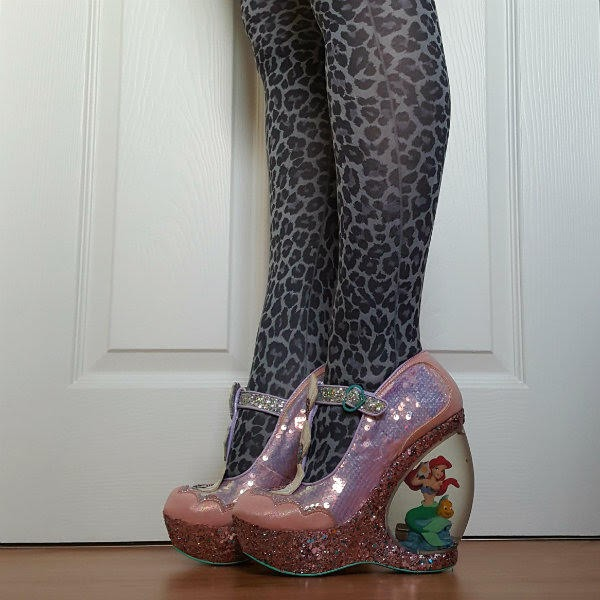 side view of water globe heel shoes with Ariel mermaid figure inside and glitter platform