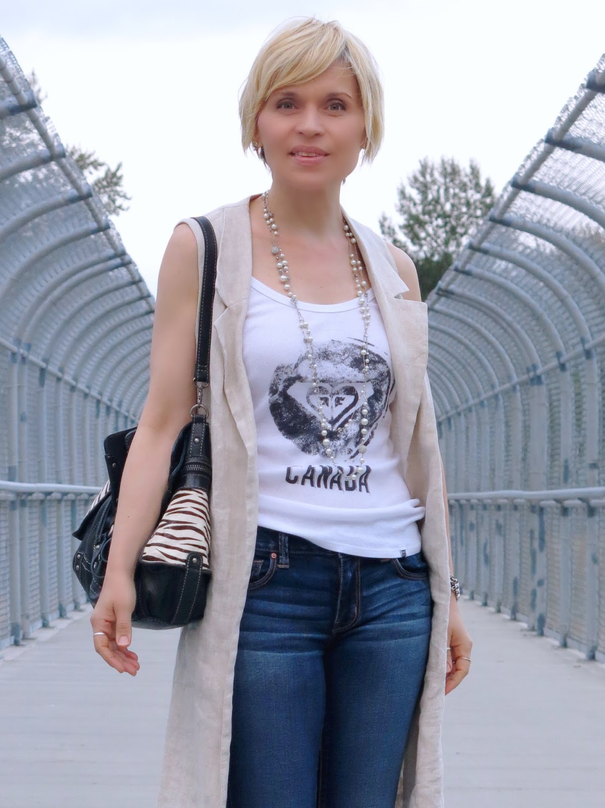 graphic tank top, Zara sleeveless linen coat, and Fossil bag