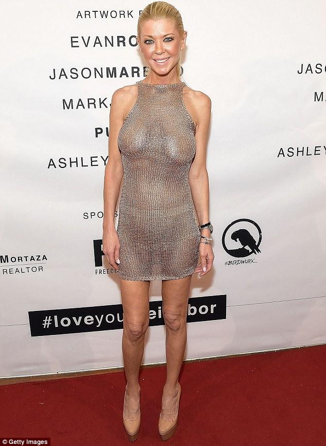 Tara-Reid-flashes-her-boobs-in-braless-dress-3