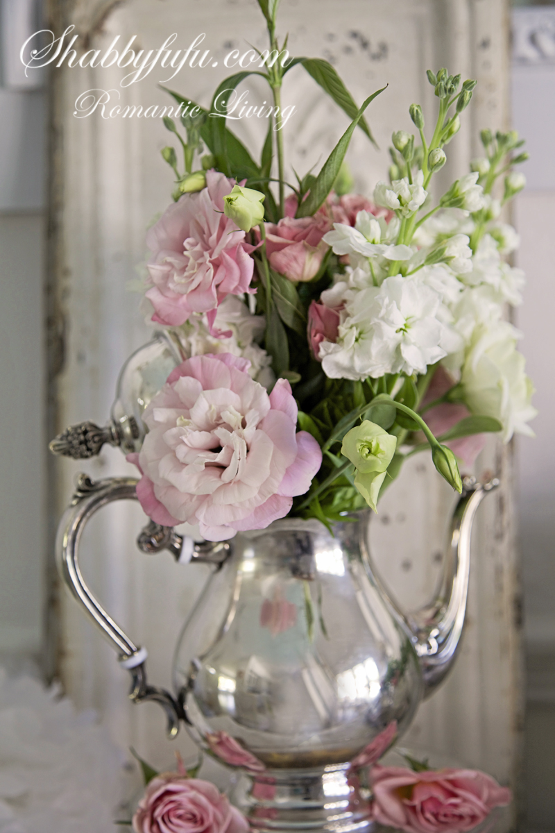 silver pitcher with beautiful flowers