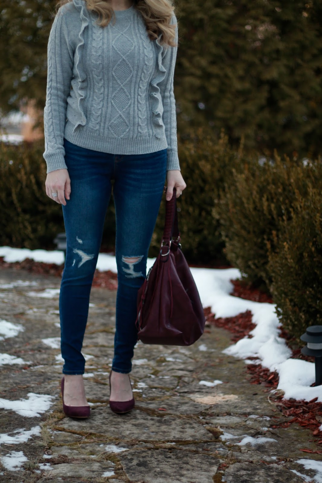 grey ruffle cable knit sweater, distressed rockstar jeans, burgundy hobo bag, burgundy heels, black tassel earrings